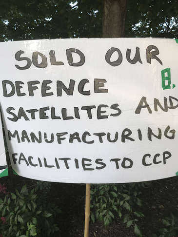 SOLD CANADIAN SATELLITES AND MANUFACTURING TO CHINA.